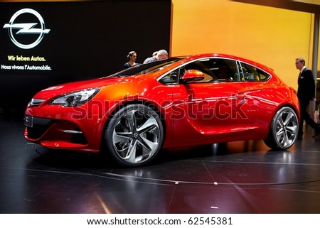 PARIS, FRANCE - SEPTEMBER 30: Paris Motor Show on September 30, 2010 in Paris, showing Opel Astra GTC, front-side view - stock photo