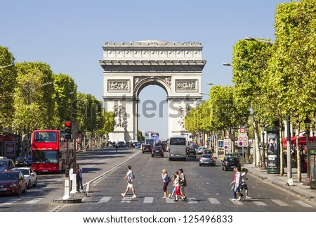 PARIS, FRANCE - SEPTEMBER 9: The Champs-Elysees and the Arc de Triomphe, on September 09, 2012 in Paris, France. The most famous avenue of Paris has 1910m and is full of stores, cafes and restaurants.