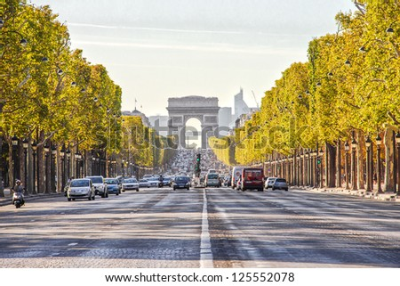 PARIS, FRANCE - SEPTEMBER 9: The Champs-Elysees and the Arc de Triomphe, on September 09, 2012 in Paris, France. The most famous street of Paris has 1910m and is full of stores, cafes and restaurants.