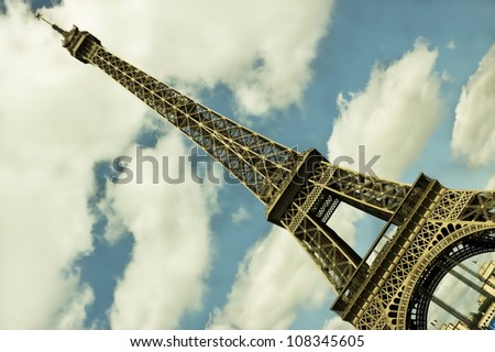 Paris, France - Side view of the Eiffel tower one of the most recognizable landmarks in the world.