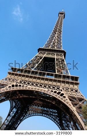 Paris, france, the eiffel tower against a vibrant blue spring sky.