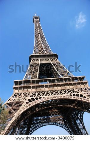 Paris, france, the eiffel tower against a vibrant blue spring sky.
