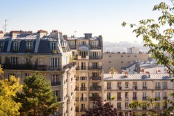 Paris, France. View on French Parisian apartments  and  flats with typcial balconies. Cityscape panorama from park in front of Sacre Coeur in Paris, France.