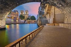 Paris. Image of the Notre-Dame de Paris Cathedral and riverside of Seine river in Paris, France.