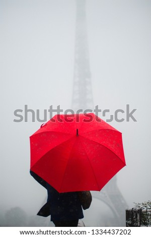 Paris in winter . Black white and red symbolic image . #1334437202