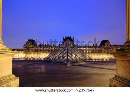 PARIS - JAN 8 : Louvre museum at dusk in Paris, France. Louvre is the biggest Museum in Paris displayed over 60,000 square meters of exhibition space. on January 8th 2012 in Paris, France