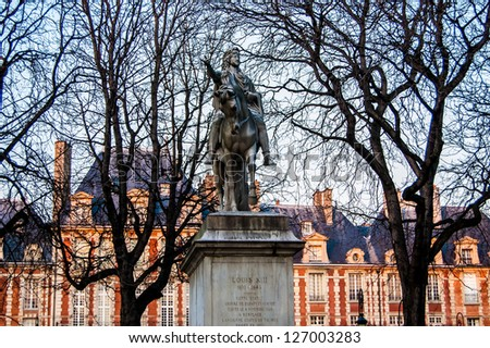 PARIS - JANUARY 17: a statue on the place des Vosges on January 17, 2013 in Paris. The Place des Vosges is the oldest planned square in Paris located in Marais district.