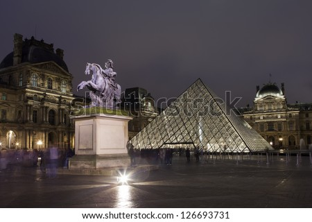 PARIS - JANUARY 01: Louvre museum in Paris, France at night on January 01, 2013. Louvre is the biggest museum in Paris with over 60,000 square meters of exhibition space.