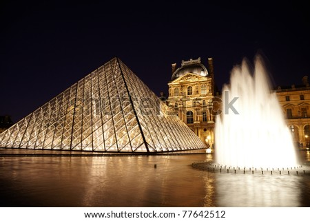 PARIS - JANUARY 1: Louvre Pyramid, fountain and Pavillon Rishelieu in evening, January 1, 2010, Paris, France. This pyramid form structure was designed by the Chinese-born American architect I. M. Pei