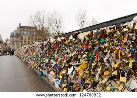 PARIS - JANUARY 1: Love padlocks at Pont de l'Archeveche on January 1, 2012, in Paris. The thousands of locks of loving couples symbolize love forever.