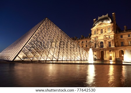 PARIS - JANUARY 1: View on the Louvre Pyramid and Pavillon Rishelieu in the evening, January 1, 2010, Paris, France. Pyramid weight about 180 tons. - stock photo