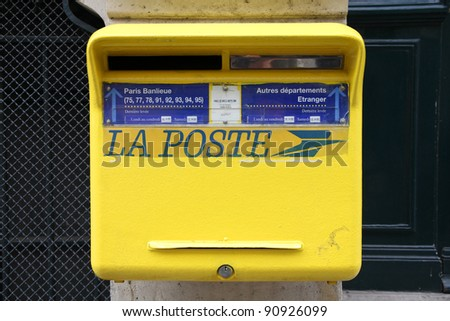 PARIS - JULY 24: La Poste postbox on July 24, 2011 in Paris, France. La Poste is France's leading employer with a total workforce of 300,000. Founded in 1576, it is among oldest postal services.