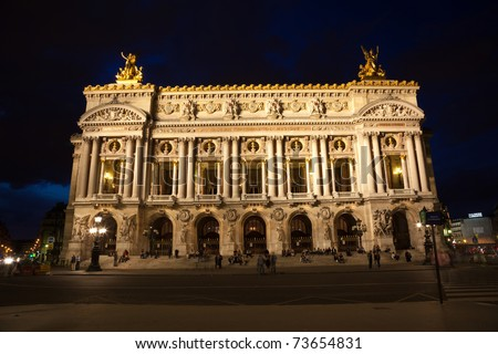 PARIS - JULY 25: Main facade of Opera Garnier at night. July 25, 2009 in Paris, France. Opera Garnier, a grand landmark in Neo-Baroque style designed by Charles Garnier
