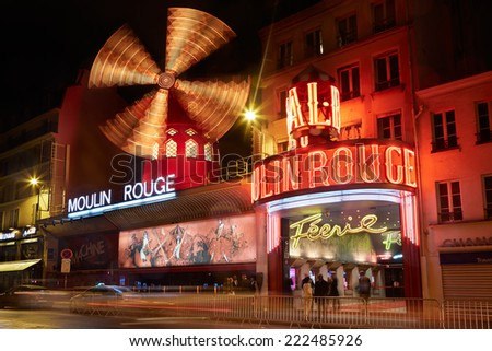 PARIS JULY 11 Moulin Rouge by night in Paris The cabaret was founded in 1889 famous for the can can dance show on July 11th 2014 in Paris France