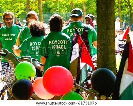 PARIS, JULY 3: Peaceful protesters gather in green shirts July 3, 2009 in gardens Luxembourg Palace, Paris, France. Boycott Israel is focus of protest.