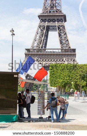 PARIS - JULY 27: Postcard stand at the Eiffel Tower on July 27, 2013, in Paris. The Eiffel Tower is the most visited attraction in France and one of the most recognizable landmarks in the world.
