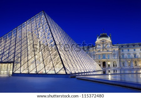 PARIS - JULY 30: Pyramid-entrance near Louvre Museum on July 30, 2012 in Paris, France. Illumination project was developed by designer C. Engl who has established halogen lamps on internal perimeter.