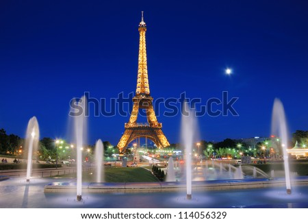 PARIS - JULY 25: The Eiffel Tower and fountains de Varsovie seen at evening on July 25, 2012 in Paris, France. Fountain was built in front of the Chaillot Palace for the Universal Exposition of 1937.