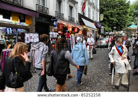 PARIS - JULY 22: Tourists at Rue de Steinkerque on July 22, 2011 in Paris, France. The street is one of most famous shopping areas in Monmartre district. Paris is the most visited city worldwide.
