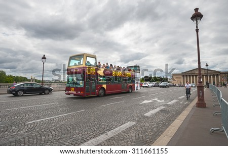 PARIS - JULY 20: Tourists visit the city center by bus on July 20, 2015 in Paris, France. In year 2014 more than 15 million tourists visited the city of Paris.