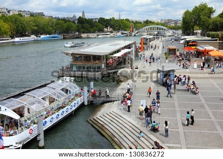PARIS - JULY 25: Tourists walk along river Seine on July 25, 2011 in Paris, France. Paris is the most visited city in the world with 15.6 million international arrivals in 2011.