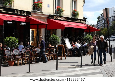 PARIS - JULY 24: Tourists walk past Villa Borghese cafe on July 24, 2011 in Paris, France. Paris is the most visited city in the world with 15.6 million international arrivals in 2011.