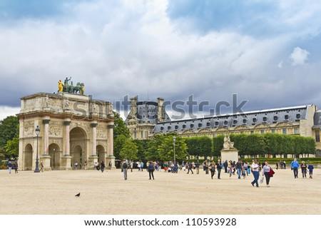 PARIS - JULY 13:Triumphal Arch (Arc de Triomphe du Carrousel) at Tuileries gardens in Paris, France on July 13,2012. Monument was built between 1806-1808 to commemorate Napoleon's military victories.