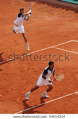 PARIS - JUNE 05: Daniel NESTOR (L) of Canada and Nenad ZIMONJIC (R) of Serbia during the men's doubles final match of the French Open at Roland Garros on June 05, 2010 in Paris, France.