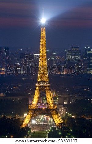 PARIS - JUNE 30 : Eiffel tower at night on JUNE 30, 2010 in Paris. The Eiffel tower is the most visited monument of France.