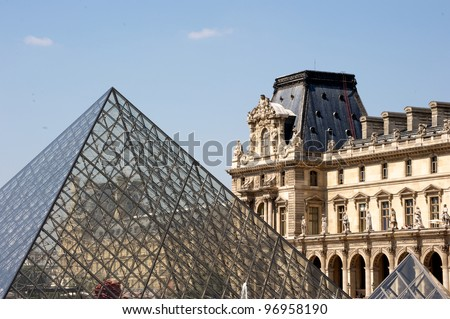 PARIS - JUNE 28: Glass Pyramid at the Louvre Museum on June 28, 2011 in Paris, France. The museum was inaugurated in 1739. However, due to some infrastructural problems, it was shut down for 5 years.