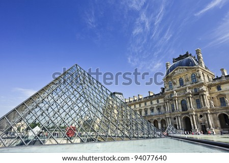 PARIS - JUNE 28, 2011. Glass Pyramid at the Louvre Museum on June 28, 2011. The museum was inaugurated in 1739. However, due to some infrastructural problems, it was shut down for 5 years.