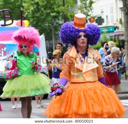 PARIS-JUNE 25:Grotesque costumes.400,000 people took part in the Gay Pride Parade to support gay rights,on June 25, 2011 in Paris, France.