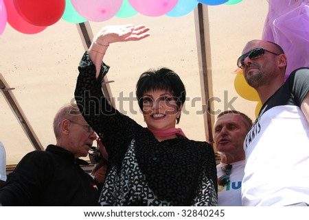 PARIS - JUNE 27: Liza Minnelli waves to the crowd during Paris Gay Pride parade to support gay rights June 27, 2009 in Paris, France. Estimated 300,000 to 700,000 people took part in the parade.