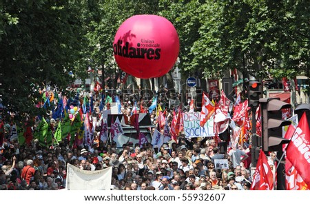 PARIS - JUNE 24: 2,000,000 people demonstrate during France's nationwide strike against pension overhaul by raising the retirement age from 60 to 62 on June 24, 2010 in Paris, France. - stock photo