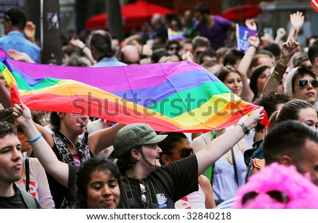 PARIS - JUNE 27: People take part in the Paris Gay Pride parade to support gay rights  June 27, 2009 in Paris, France.