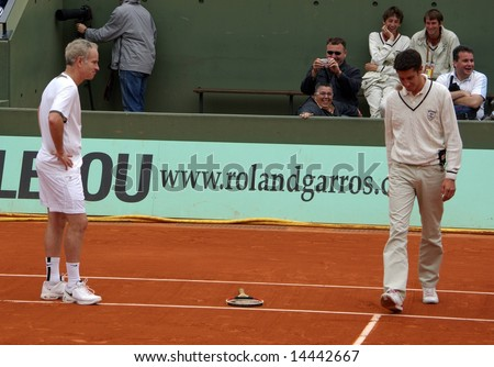 PARIS - JUNE 1: Retired tennis legend John McEnroe is angry against the referee and throws his racket while playing tennis at the Roland Garros Open on June 1, 2008 in Paris, France.