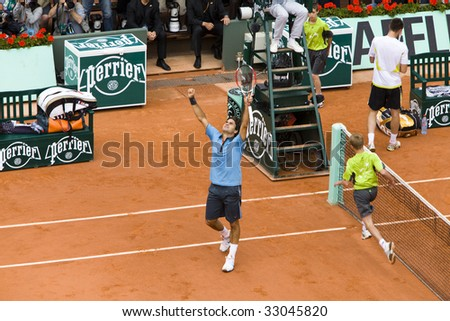PARIS - JUNE 7: Roger Federer of Switzerland rejoices to win at Tennis tournament French Open, Roland Garros, final game on June 7, 2009 in Paris, France.