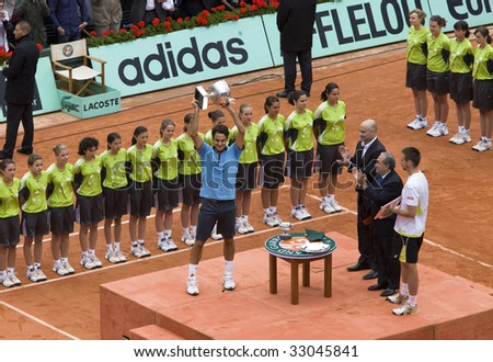 PARIS - JUNE 7: Roger Federer of Switzerland with cup, it received for victory in man's single category at Tennis tournament French Open, Roland Garros, final game on June 7, 2009 in Paris, France.