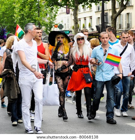 PARIS-JUNE 25:transgender personality marches.400,000 people took part in the Gay Pride Parade to support gay rights,on June 25, 2011 in Paris, France.