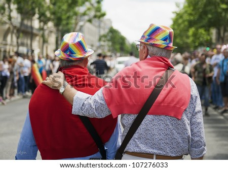 PARIS - JUNE 30: Two elderly gays follow column of demonstrators at the Gay Pride on June 30, 2012 in Paris.