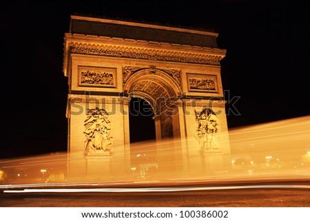 Paris landmark - Arc de Triomphe at night. Long Exposure - stock photo