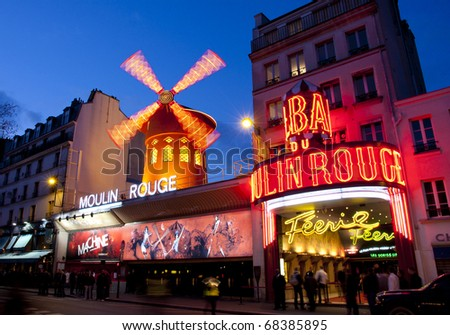 PARIS - MAR 3: The Moulin Rouge by night, on March 3, 2010 in Paris, France. Moulin Rouge is a famous cabaret built in 1889 and is located in the Paris red-light district of Pigalle.