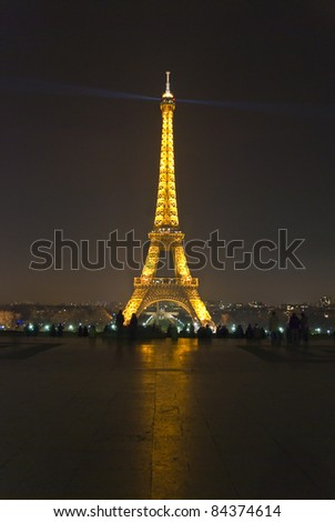 PARIS - MARCH 20: Eiffel tower at night on March 20, 2008 in Paris. The Eiffel tower is the most visited monument of France and the most recognizable landmark of the world.