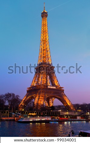 PARIS - MARCH 31: Eiffel Tower in festive illumination to Birthday (it is open on March 31 1889), view from the Seine quay, March 31, 2012 in Paris, France.