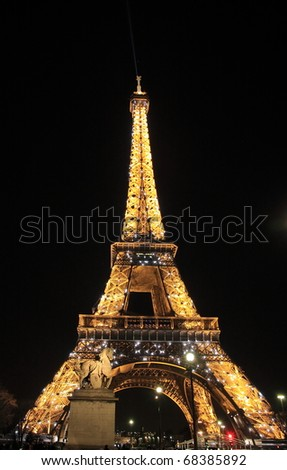 PARIS - MARCH 16: Eiffel Tower Light Beam Show at dusk, closeup on March 16, 2010 in Paris, France. Eiffel Tower is the highest monument in France use around 20,000 light bulbs in the show.