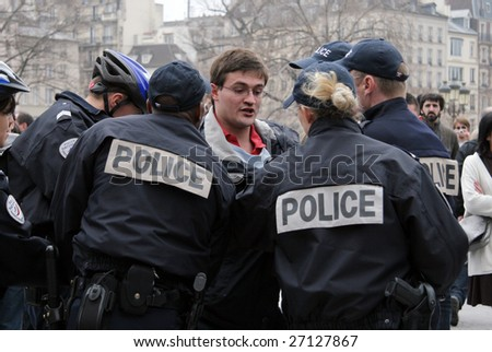PARIS - MARCH 22: Fervent Catholic gets arrested for attacking the ACT UP protesters by Notre-Dame Cathedral on March 22, 2009 in Paris, France.