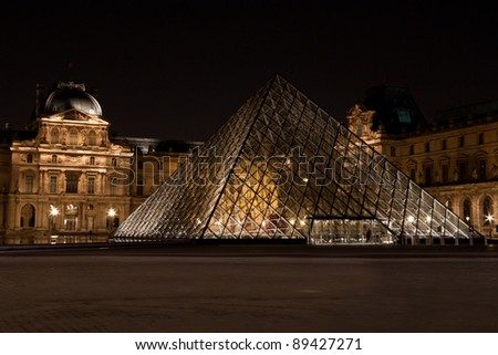 PARIS - MARCH 14: Louvre Museum at night on March 14, 2011 in Paris. The Musee du Louvre, or Grand Louvre, is the most visited art museum in the world and the seat of Leonardo Da Vinci's Mona Lisa.