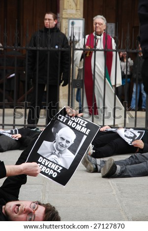 PARIS - MARCH 22: Members of the Act Up organisation lay down by Notre-Dame Cathedral to protest against Pope Benedict XVI\'s remarks on condoms and abortion on March 22, 2009 in Paris, France.