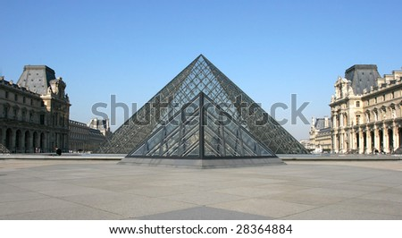 PARIS - MARCH 14: Museum du Louvre and the Pyramid March 14, 2006 in Paris France