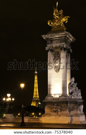 PARIS - MARCH 27: Night illumination on the bridge of Alexander III and the Eiffel Tower on March 27, 2011 in Paris. This illumination admire 25,000,000 tourists a year.